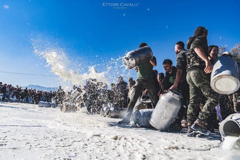 ardinian shepherds throwing away milk in protest