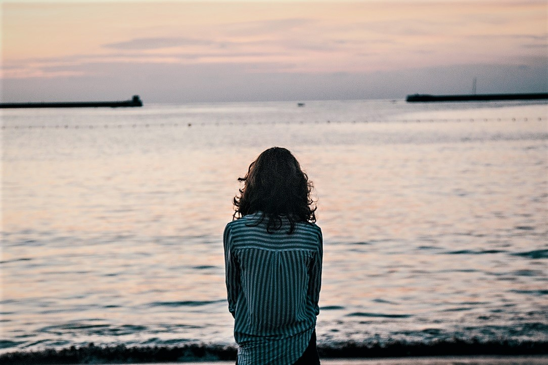 The Boomerang Effect - Woman looking at the sea, Italy