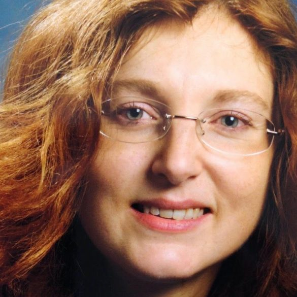 A headshot of Paola Fiore, a climate change leader