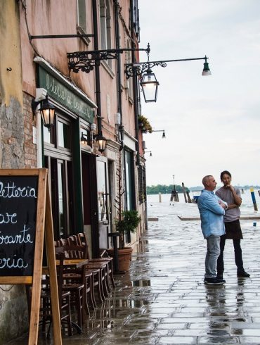 Venice Men in front of a cafè.