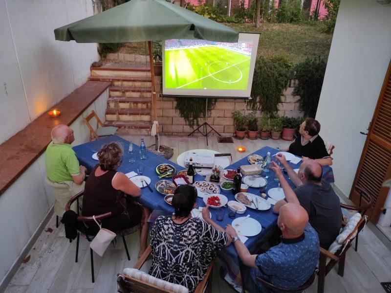 Italy vs England match on a maxiscreen in Italy